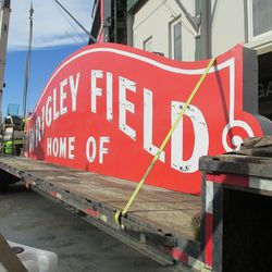 2:16 p.m. The top segment of the marquee, loaded aboard the flatbed truck -