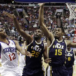 Al Jefferson (25) and Derrick Favors (15) and the rest of the Utah Jazz are playing defense as they jockey for a playoff spot.