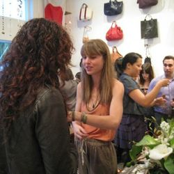 Bentley styles a friend; Vivier's totes hang on the wall in background