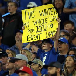 A young BYU fan holds up a sign as BYU and Utah play an NCAA football game at LaVell Edwards Stadium in Provo on Saturday, Sept. 11, 2021. BYU won 26-17, ending a nine-game losing streak to the Utes.