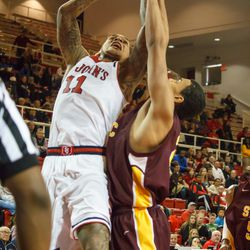 D`Angelo Harrison takes a shot in traffic