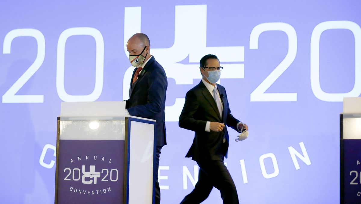 Utah gubernatorial candidates Republican Lt. Gov. Spencer Cox, left, and Democrat Chris Peterson walk on stage for a debate during the Utah League of Cities and Towns' virtual annual convention at the Salt Palace in Salt Lake City on Friday, Sept. 25, 2020.
