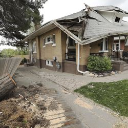 A home damaged from a tree that was toppled by high winds in the Avenues in Salt Lake City is pictured on Tuesday, Sept. 8, 2020.