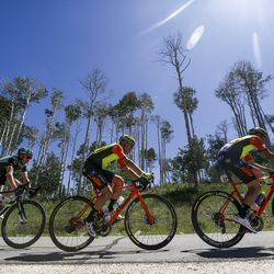 Cyclists Cullen Easter, from left, Edoardo Zardini and Umberto Marengo climb a hill during Stage 6 of the Tour of Utah in Wolf Creek Ranch on Sunday, Aug. 18, 2019.