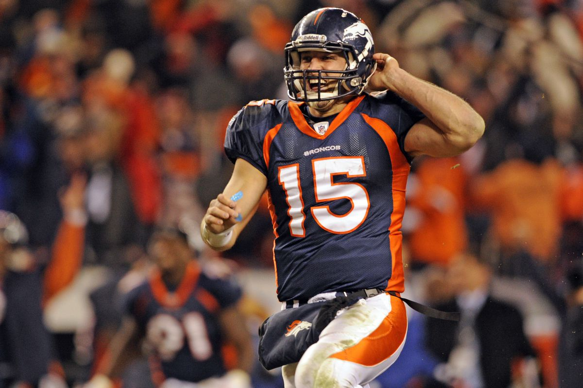 Denver Broncos quarterback Tim Tebow celebrates his 80 yd touchdown pass to beat the Pittsburgh Steelers 29-23 in the first round of the AFC playoffs Sunday January 8, 2012 at Sports Authority Field at Mile High. AAron Ontiveroz, The Denver Post