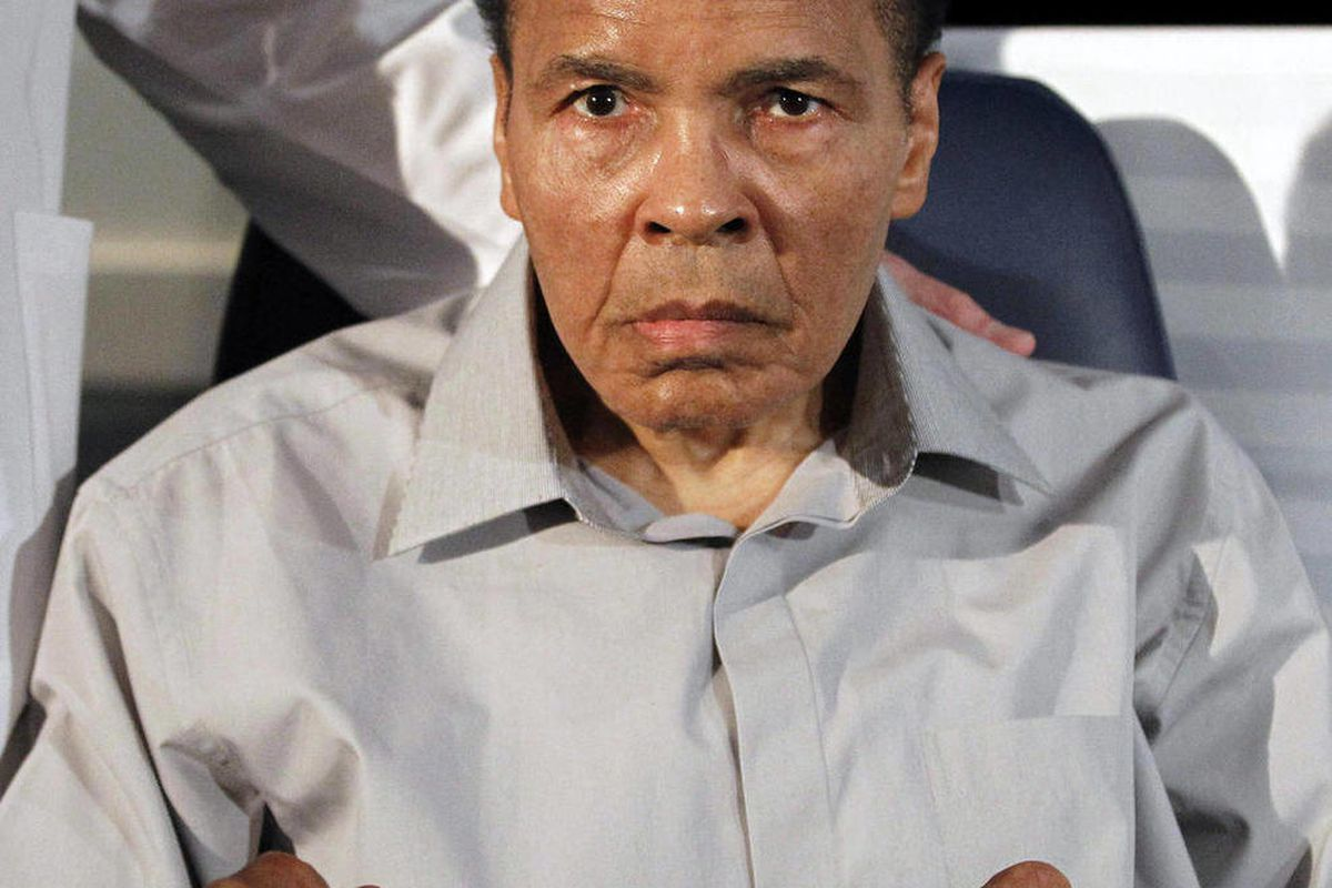 FILE - Former heavyweight boxing champion Muhammad Ali displays his signature boxing pose after honoring outstanding surgeons and physicians at St. Joseph's Hospital Barrow Neurological Institute, in this Feb. 22, 2012 file photo taken in Phoenix. Retired