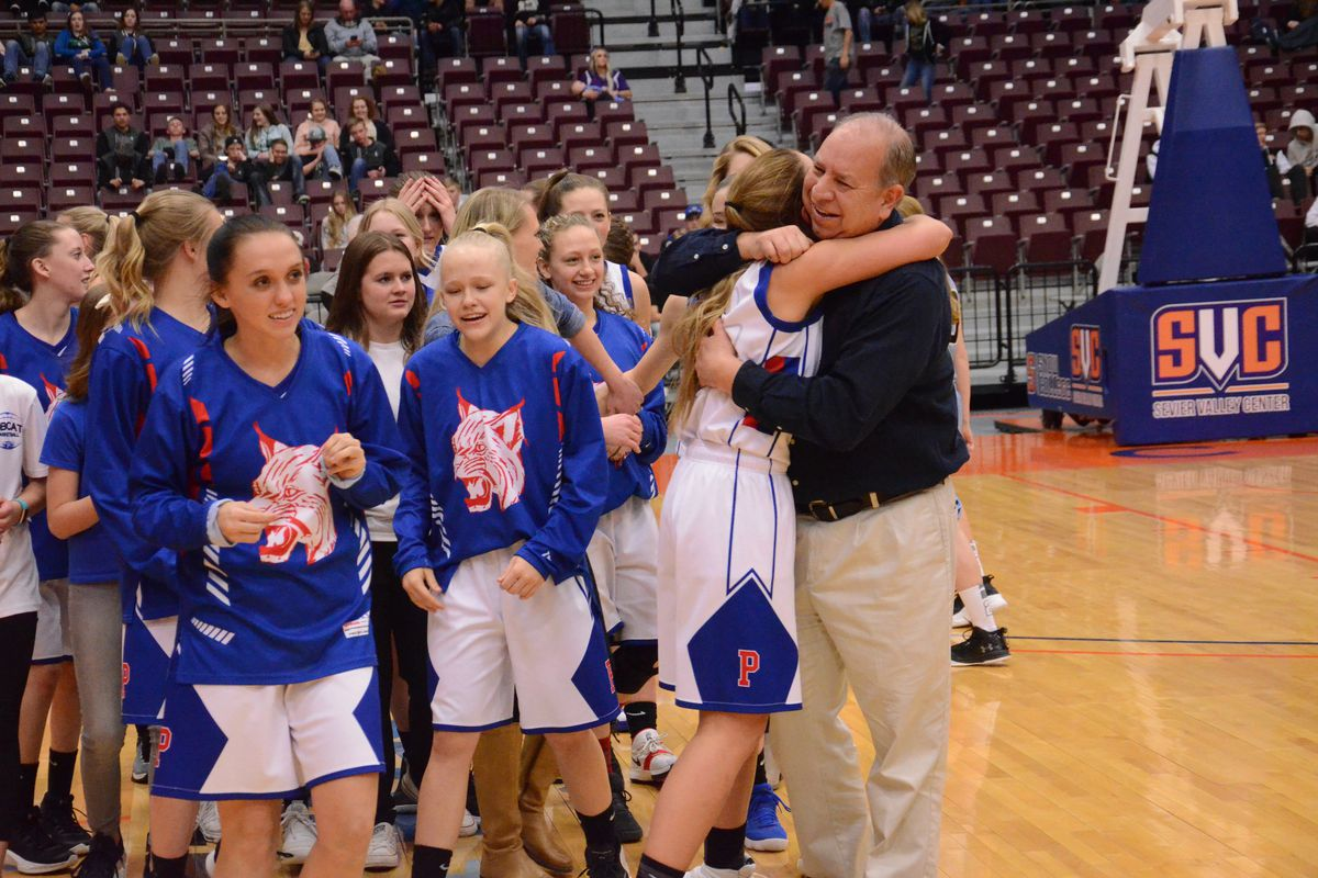Panguitch's girls basketball team celebrates beating Piute to claim the 1A state championship.