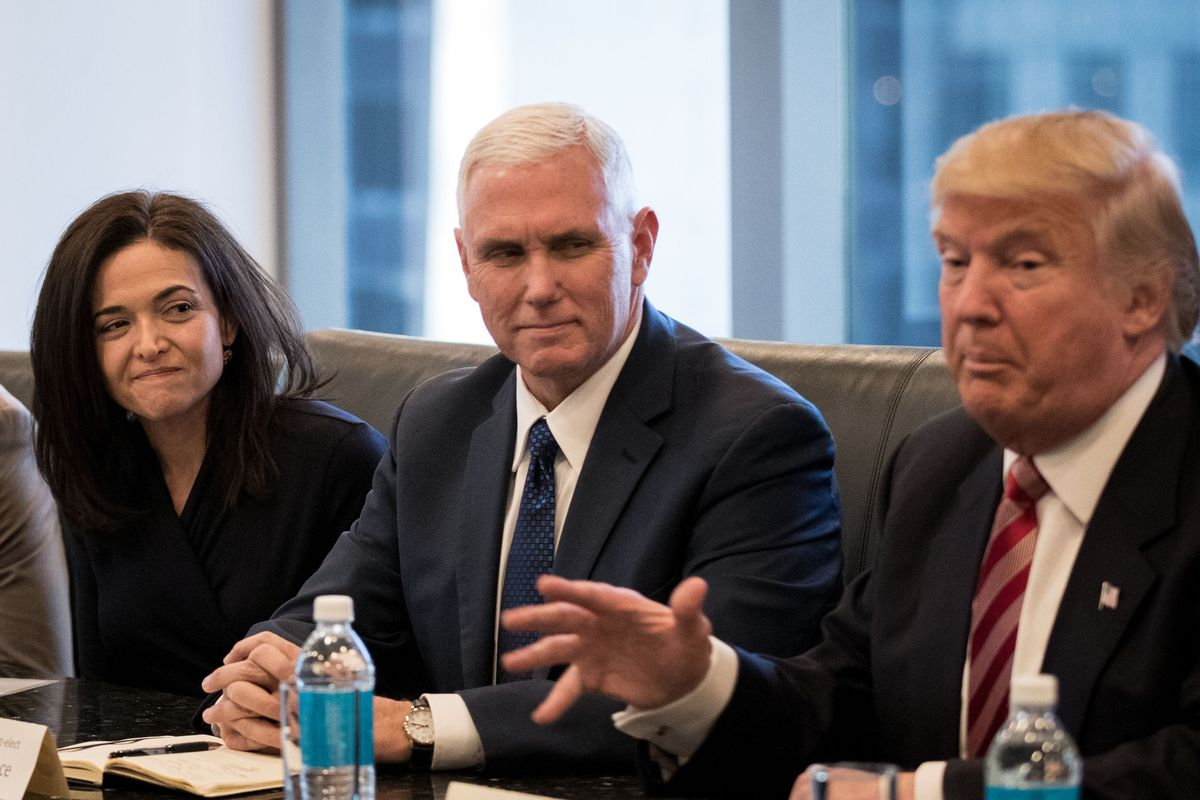 Sheryl Sandberg, chief operating officer of Facebook, and Vice President-elect Mike Pence listen as President-elect Donald Trump speaks during a meeting of technology executives at Trump Tower, December 14, 2016 in New York City.
