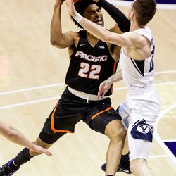 Pacific Tigers guard Jahbril Price-Noel (22) drives against Brigham Young Cougars guard Spencer Johnson (20) at the Marriott Center in Provo on Saturday, Jan. 30, 2021.