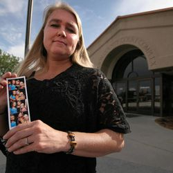 Valerie Bruno holds a photo of her three daughters outside the Carbon County Court Complex in Price, June 6, 2012. Bruno said she has filed a complaint with the Utah Judicial Conduct Commission against 7th District Juvenile Court Judge Scott Johansen for telling her to cut off her daughter's ponytail in court if she didn't want the 13-year-old to serve 276 hours of community service.