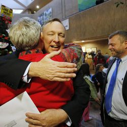 Salt Lake City Mayor Ralph Becker hugs state Sen. Jim Dabakis, D-Utah, prior to performing a marriage ceremony between Jim and his partner, Stephen Justesen. Hundreds turn out to obtain marriage licenses Friday, Dec. 20, 2013 in the Salt Lake County offices after a federal judge ruled that Amendment 3, Utah's same-sex marriage ban, is unconstitutional.