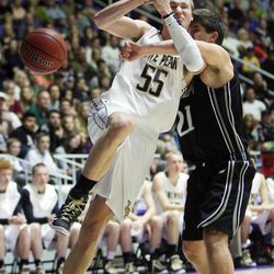 Lone Peak's Eric Mika is fouled by Alta's Carter Heslop during the 5A State Championship game in Ogden Saturday, March 2, 2013.