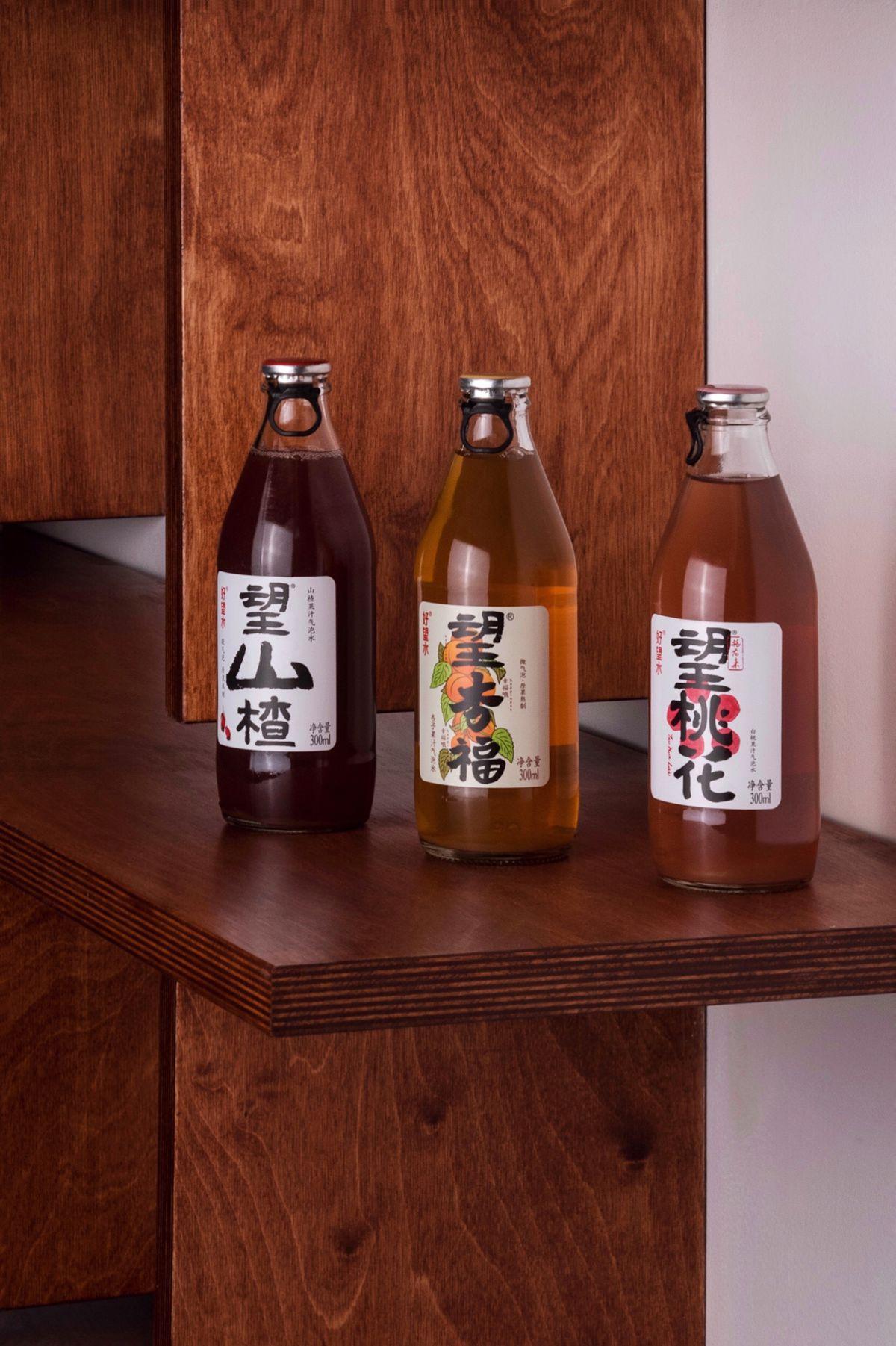 three glass bottles of soda