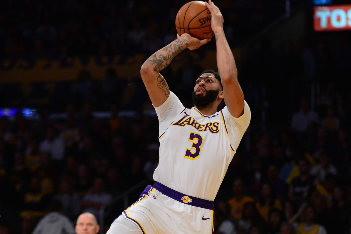 Los Angeles Lakers forward Anthony Davis shoots against the Denver Nuggets during the second half at Staples Center.