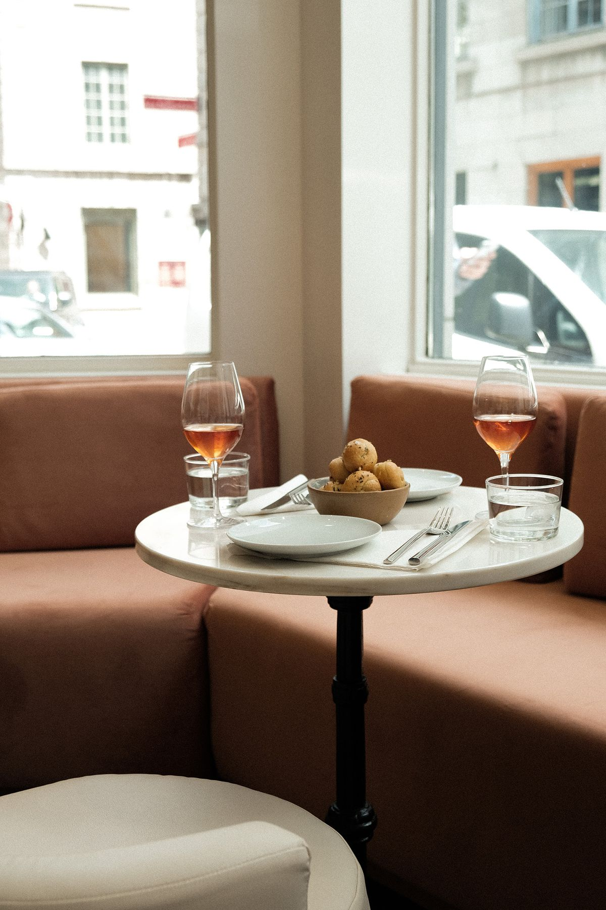 bistro table with wine and food