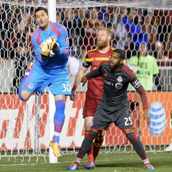 Toronto FC goalkeeper Julio Cesar (30) grabs a shot on goal as Toronto FC defender Jeremy Hall (25) and Real Salt Lake defender Nat Borchers (6) watch during a game at Rio Tinto Stadium in Sandy on Saturday, March 29, 2014.