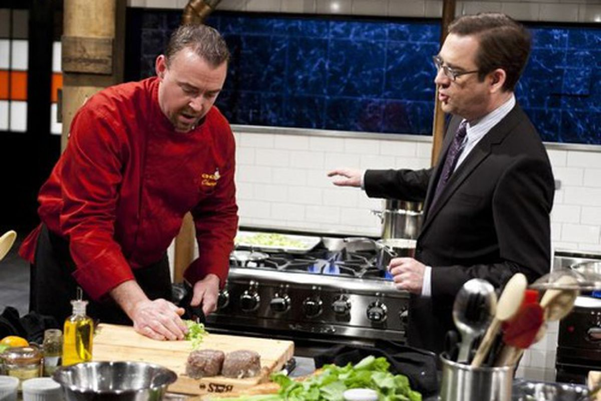 Host Ted Allen with a contestant.
