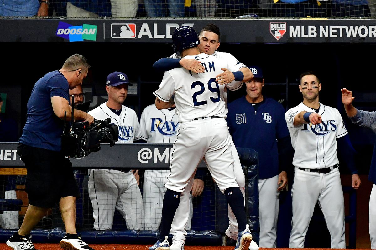 Tampa Bay Rays DH Tommy Pham is congratulated by his teammate Willy Adames after his home run against the Houston Astros during the first inning in game four of the American League Division Series at Tropicana Field on October 08, 2019.