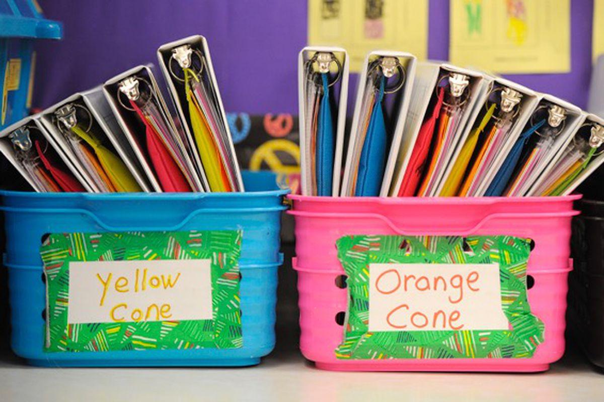 Boxes full of school binders.