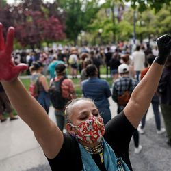 Roberta Huss, who identified herself as a proud Dakota Sioux woman and enrolled member of the Sisseton Tribe, raises her hands while gathering with protesters in Pioneer Park in Salt Lake City on Saturday, June 13, 2020. The day's demonstrations were the latest in ongoing protests against racism and police brutality that have followed the killing of George Floyd in Minneapolis.