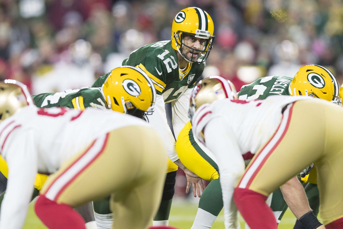Green Bay Packers quarterback Aaron Rodgers calls out from under center during the fourth quarter against the San Francisco 49ers at Lambeau Field.