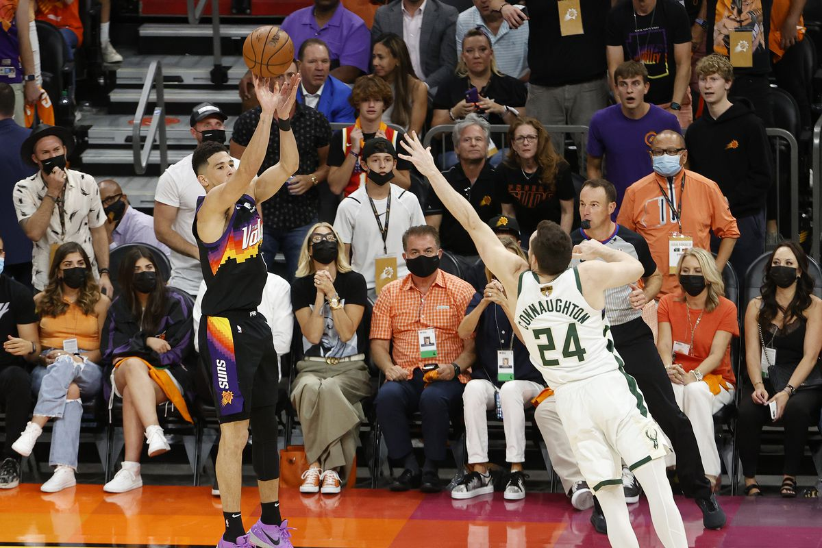 Devin Booker of the Phoenix Suns shoots against Pat Connaughton of the Milwaukee Bucks during the second half in Game One of the NBA Finals at Phoenix Suns Arena on July 06, 2021 in Phoenix, Arizona.