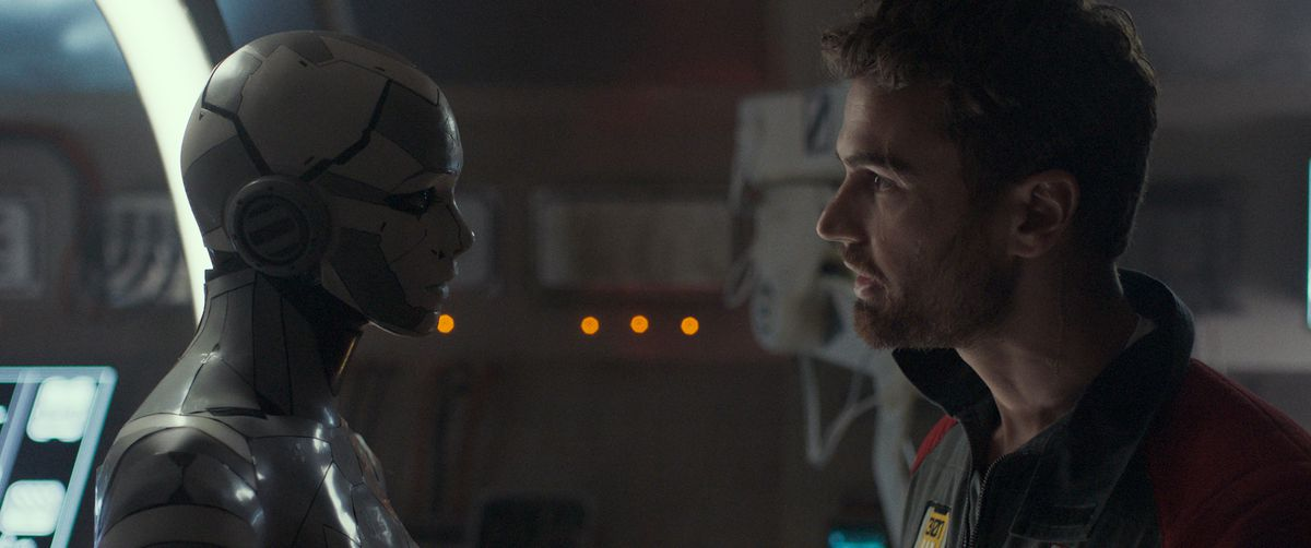 Theo James as George faces off with Stacy Martin as the almost-human robot J3 in Archive.