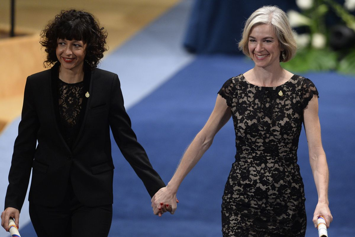 French researcher in Microbiology, Genetics and Biochemistry Emmanuelle Charpentier (L) and US professor of Chemistry and of Molecular and Cell Biology, Jennifer Doudna celebrate on the stage after receiving the 2015 Princess of Asturias Award for Technical and Scientific Reseach from Spain's King Felipe during the Princess of Asturias awards ceremony at the Campoamor Theatre in Oviedo, on October 23, 2015.