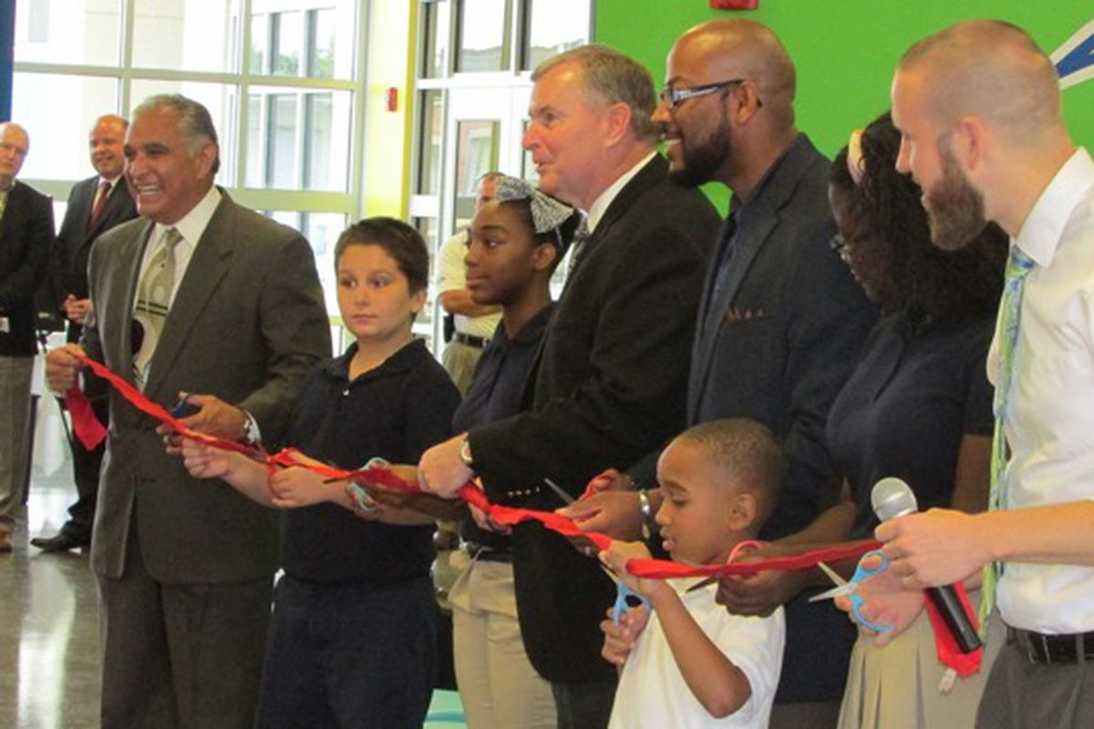 Then-Mayor Greg Ballard helps cut the ribbon for the opening of Vision Academy in 2014. Like many new charter schools, it had low test scores in its first year.