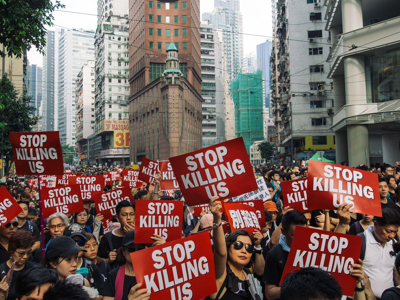 Protesters clad in black take to Hong Kong's streets, demonstrating against an extradition bill.