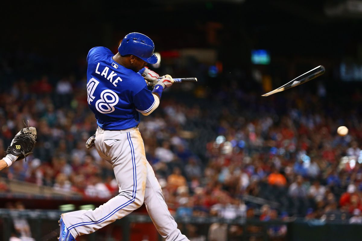 Toronto Blue Jays outfielder Junior Lake breaks a bat on a ground out