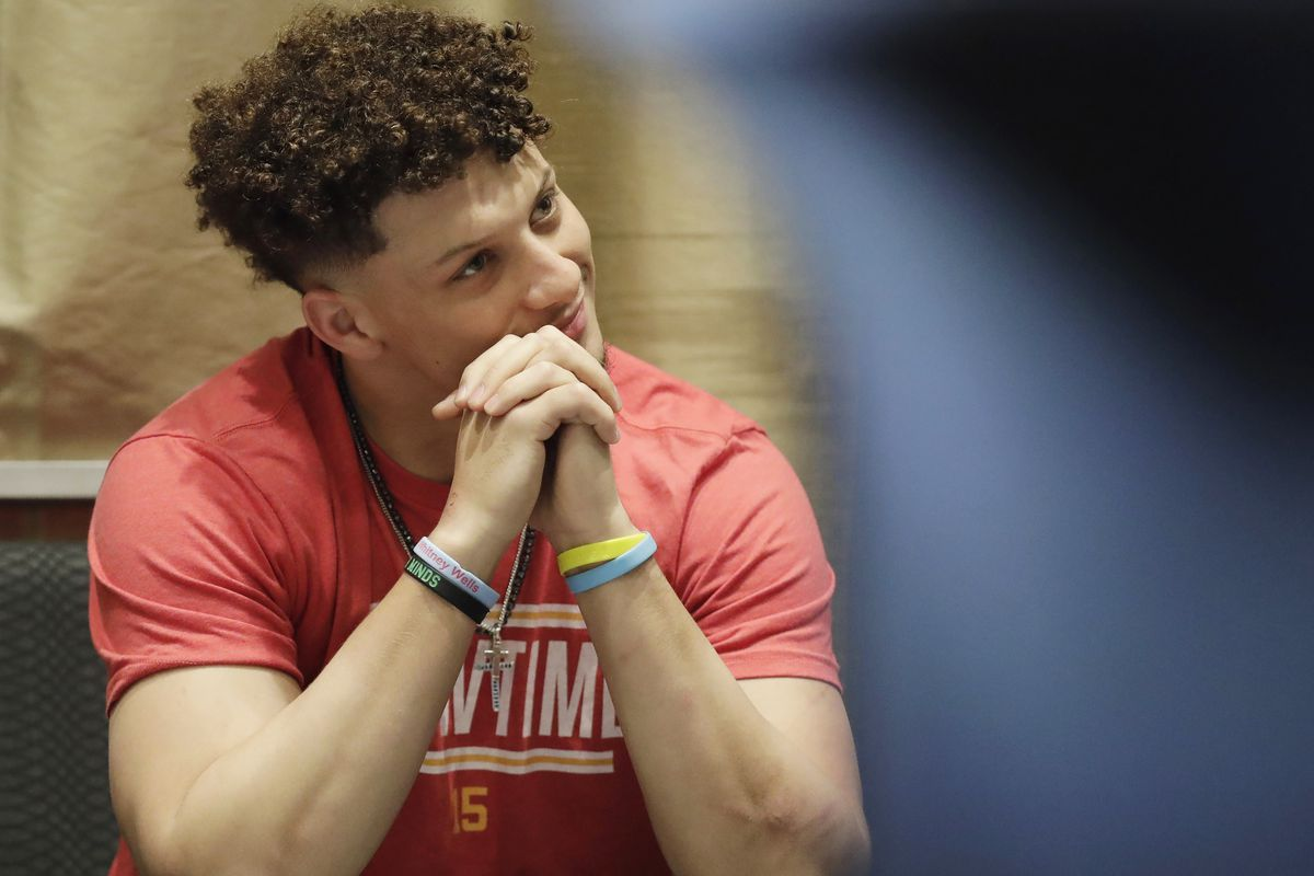 Patrick Mahomes listened intently during Andy Reid's press conference the day after winning the Super Bowl.