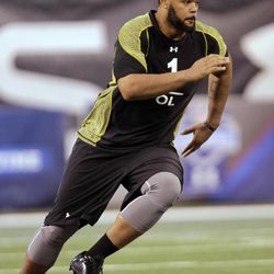 FOR USE AS DESIRED WITH NFL DRAFT STORIES - FILE - In this Feb. 25, 2012, file photo, Ohio State offensive lineman Mike Adams runs a drill at the NFL football scouting combine in Indianapolis. Adams is a top prospect in the upcoming NFL football draft.