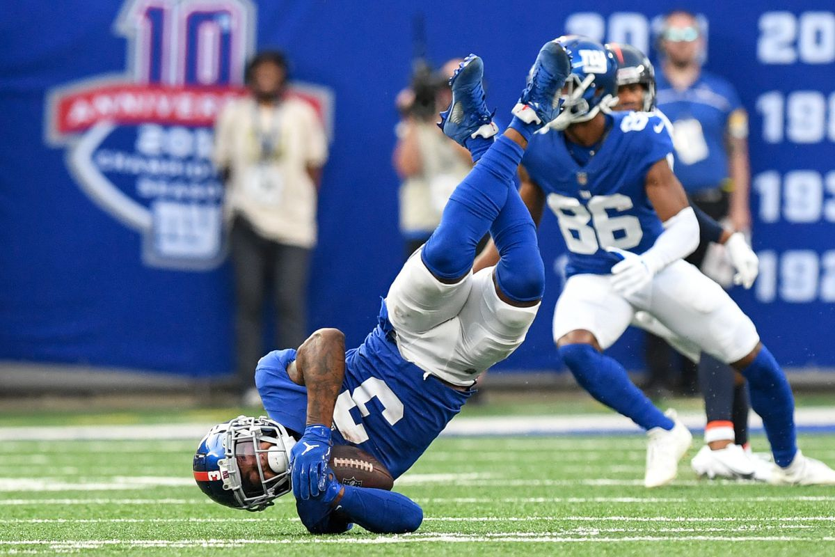 New York Giants wide receiver Sterling Shepard (3) lands upside down after catching a pass against the Denver Broncos during the second half at MetLife Stadium.
