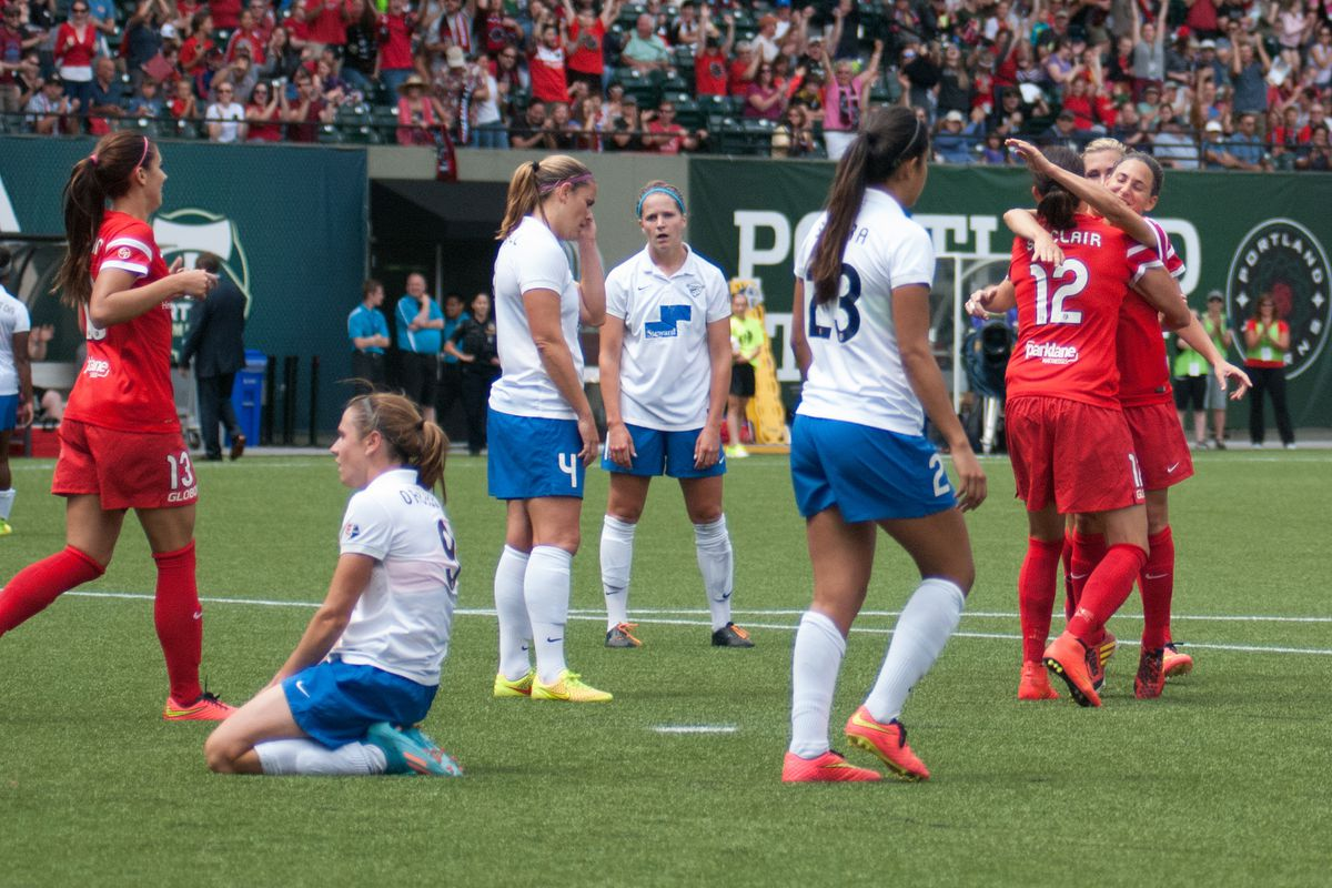 The Thorns celebrate a goal in their 6-3 victory over the Boston Breakers on July 20, 2014.