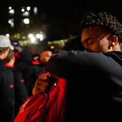University of Utah football players embraces each other after a candlelight vigil remembering the life of slain student-athlete Aaron Lowe on Wednesday, Sept. 29, 2021 at University of Utah in Salt Lake City.