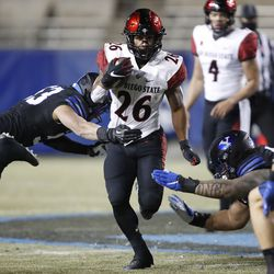San Diego State running back Kaegun Williams (26) runs out of two tackles in the first half of an NCAA college football game against BYU Saturday, Dec. 12, 2020, in Provo, Utah.