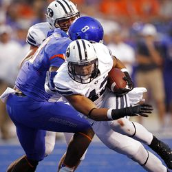 Michael Alisa of the Brigham Young Cougars runs the ball against Boise State during NCAA football in Boise, Thursday, Sept. 20, 2012.