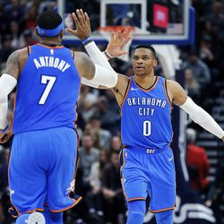 Oklahoma City Thunder forward Carmelo Anthony and guard Russell Westbrook celebrate after Westbrook hit a 3-pointer during NBA basketball against the Utah Jazz in Salt Lake City on Saturday, Dec. 23, 2017.