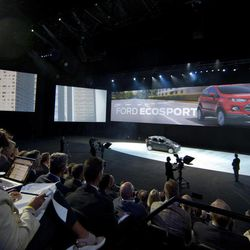 """European Ford dealers and guests watch  a presentation of fresh Ford models in Amsterdam, Netherlands, Thursday Sept. 6, 2012. Ford has unveiled 15 new or restyled vehicles for the European market that it will launch over five years to revive sales. The refreshed lineup announced Thursday includes a second-generation Kuga midsize SUV to be launched this year, as well as a new Ecosport compact SUV and the European launch of the larger Edge. Ford also will launch the iconic Mustang in Europe. Ford Europe CEO Stephen Odell said improvements in the """"brutal"""" European market are not expected soon. Ford, he said, is increasing its investment in Europe to be ready when the market bounces back."""