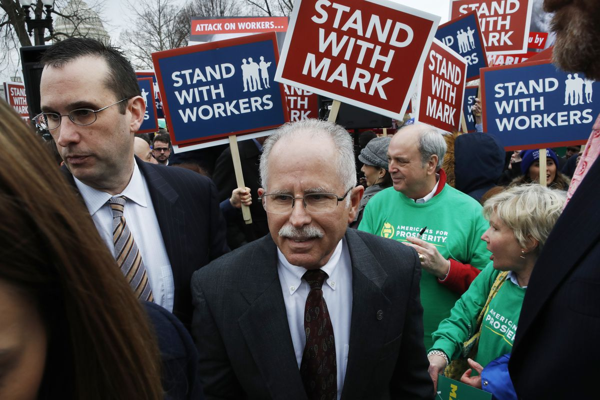 Illinois government employee Mark Janus (center) encounters supporters and protesters outside the U.S. Supreme Court in February 2018. The court ultimately sided with Janus in ruling that public employees cannot be required to pay union dues.