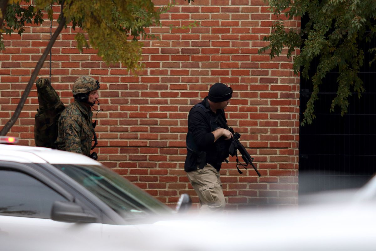 Police secure the area after a car-and-knife attack at Ohio State University.