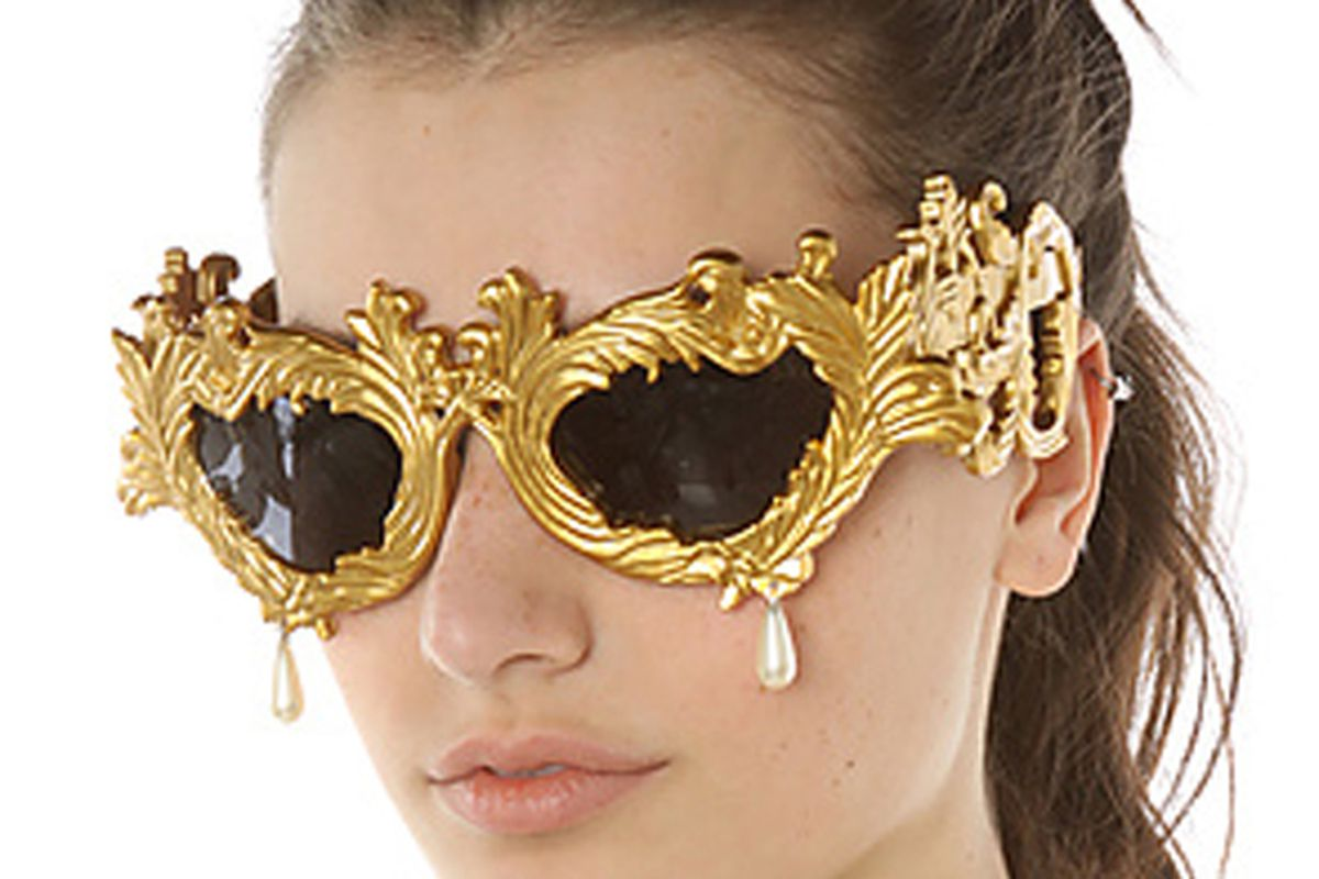 """Photo via <a href=""""http://www.karmaloop.com/product/The-Jeremy-Scott-Antique-Gold-Baroque-Sunglasses-with-Pearl-Teardrop/318825"""">Karmaloop</a>."""