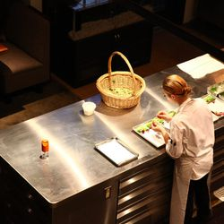 A chef prepping in the open kitchen.