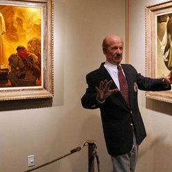 """Arnold Friberg talks about the paintings he did for Cecil B. DeMille's epic motion picture """"The Ten Commandments"""" during a media preview tour of the new exhibit at the Utah Cultural Celebration Center in 2006."""