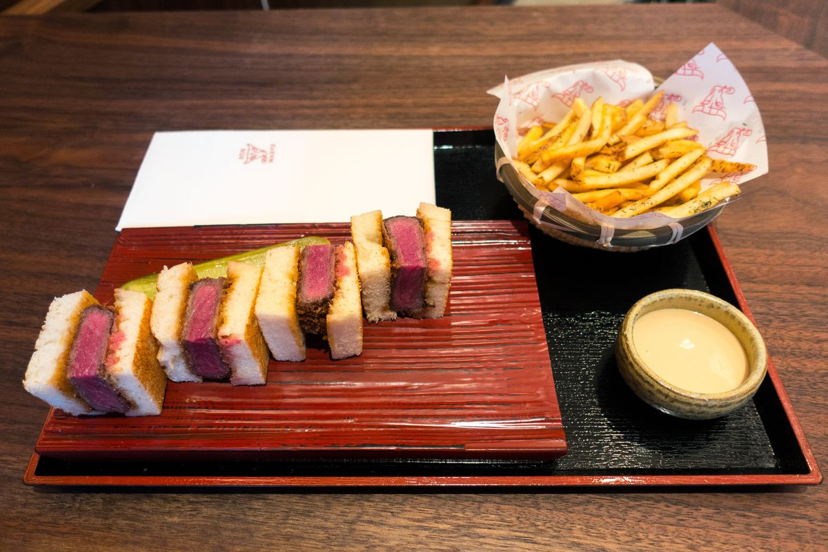 A sandwich with fries at Don Wagyu