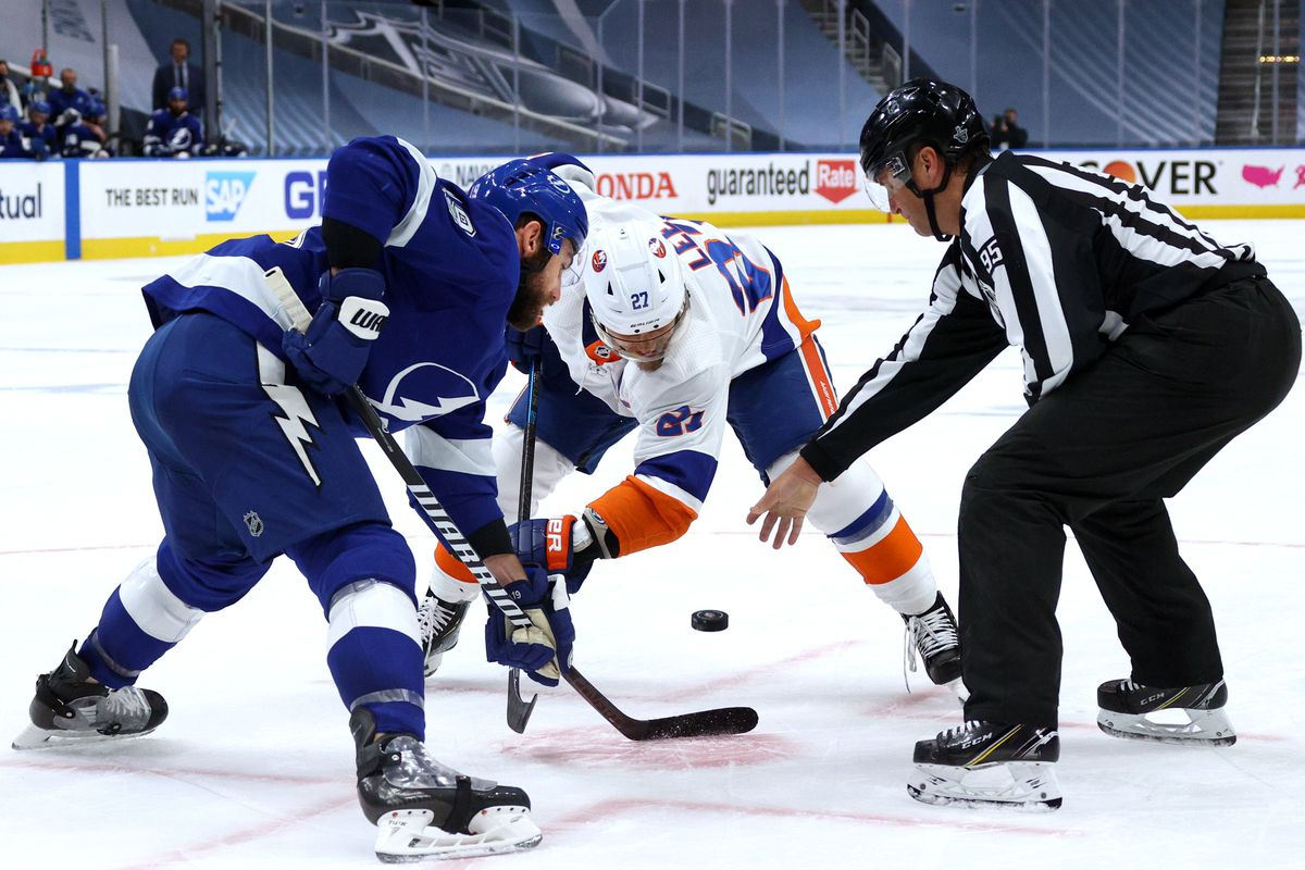 Linesman Jonny Murray #95 drops the puck for the face-off between Barclay Goodrow #19 of the Tampa Bay Lightning and Anders Lee #27 of the New York Islanders in the second period of Game Five of the Eastern Conference Final of the 2020 NHL Stanley Cup Playoffs between the New York Islanders and the Tampa Bay Lightning at Rogers Place on September 15, 2020 in Edmonton, Alberta.