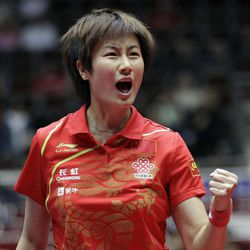 FILE - In this April 1, 2012 file photo, China's Ning Ding reacts during the women's final of the World Team Table Tennis championships between Singapore and China, in Dortmund, Germany. China owns table tennis like the United States once dominated men's basketball. It has won every gold medal in three Olympics, and four years ago in Beijing it finished 1-2-3 in both men's and women's singles, and swept gold in both team events.