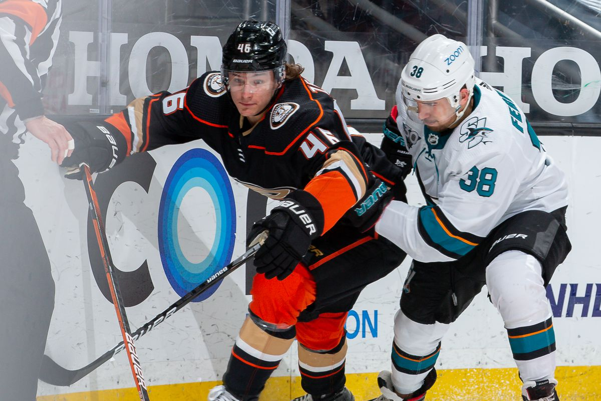 Trevor Zegras #46 of the Anaheim Ducks and Mario Ferraro #38 of the San Jose Sharks battle for the puck during the second period of the game at Honda Center on March 12, 2021 in Anaheim, California.