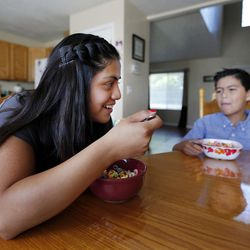 Stephanie Pesantes, who traveled to Washington, D.C., to meet with Michelle Obama, eats breakfast with her brother Kaleb Wilcox in Salt Lake City, Tuesday, July 28, 2015.